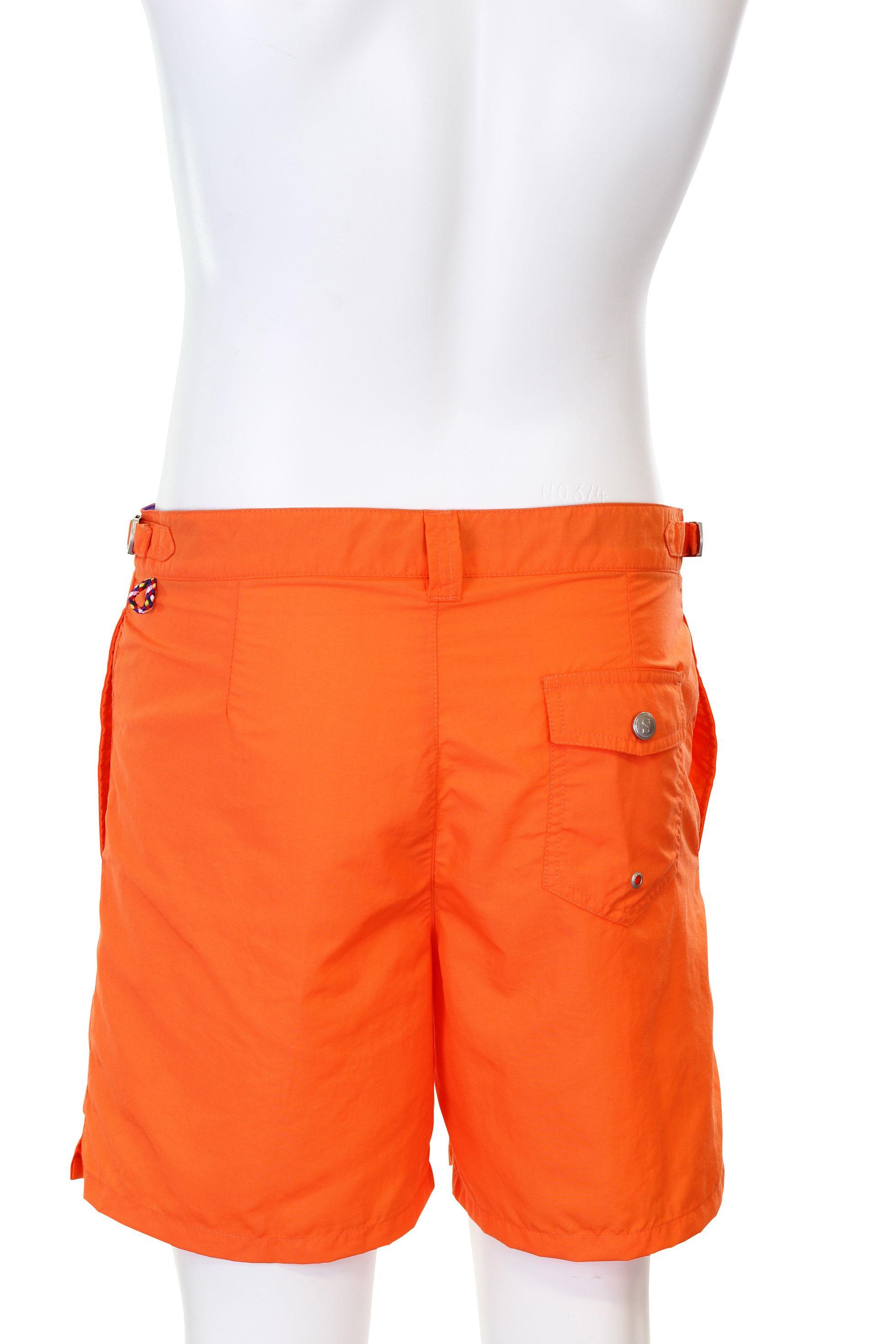 Orange swimology for Bouton cuisse interieur